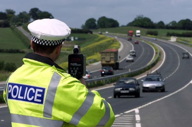 Traffic-Police-uses-a-laser-speed-gun